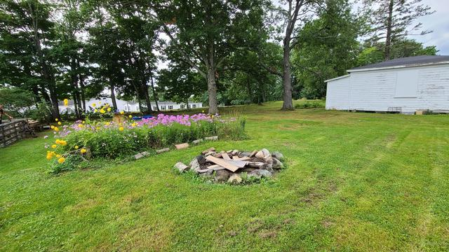 Yard featured at 14 Belmont St, Milo, ME 04463