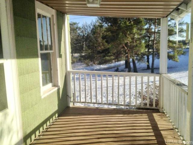 Porch featured at N16208 County Road 563, Spalding, MI 49886