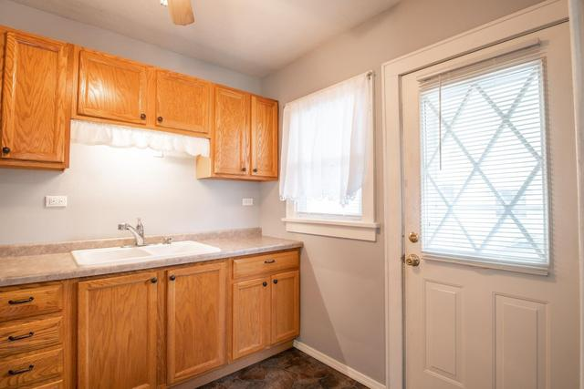 Kitchen featured at 2100 W Edna Ct, Peoria, IL 61604