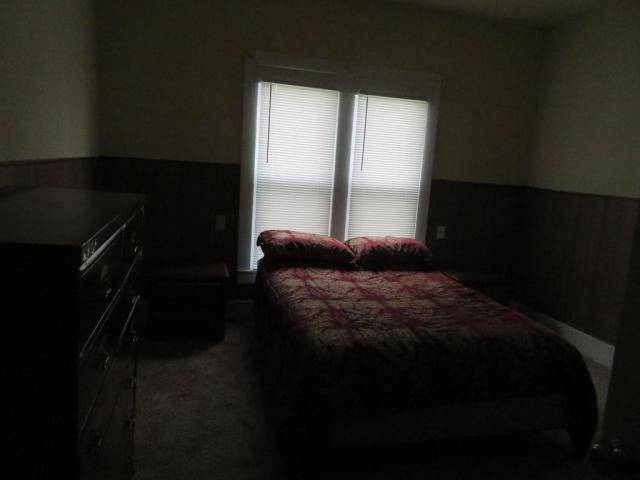Bedroom featured at 216 S Main St, Afton, OK 74331
