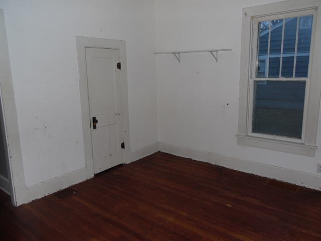 Bedroom featured at 123 E Lincoln St, Slater, MO 65349