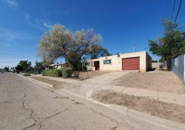 Road view featured at 465 Aspen St, Grants, NM 87020
