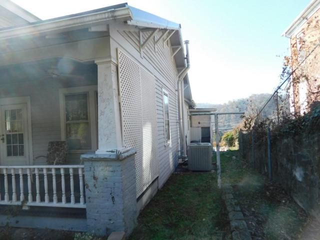 Porch yard featured at 219 W 5th Ave, Williamson, WV 25661