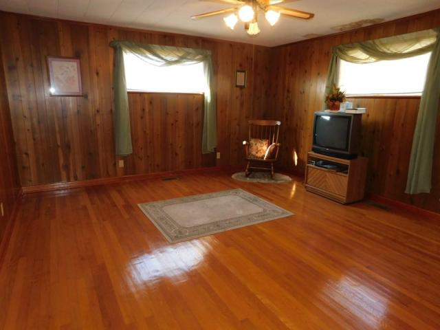 Living room featured at 219 W 5th Ave, Williamson, WV 25661