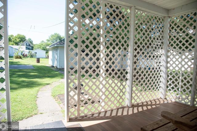 Porch featured at 530 Crawford St, Warsaw, IL 62379