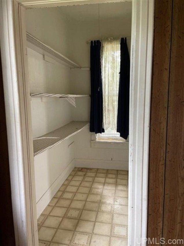 Bathroom featured at 411 Cherry St, Iron River, MI 49935