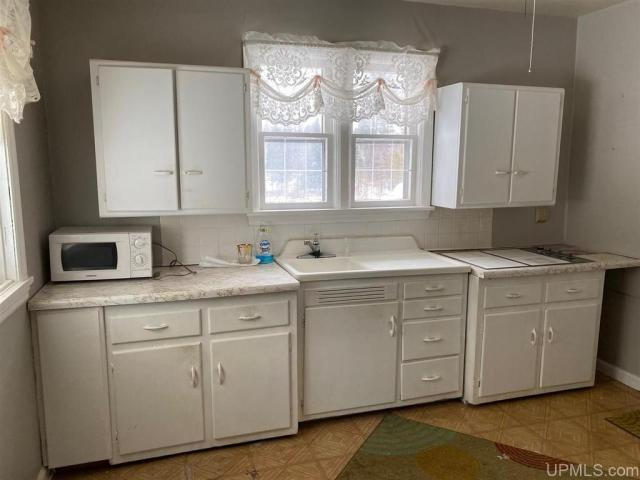 Laundry room featured at 151 State Highway M73, Iron River, MI 49935