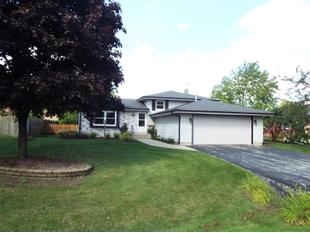 "<div></img>2118 Riviera Dr</div><div>Mount Pleasant, Wisconsin 53406</div>"" data-original=""/img/cdn/assets/layout/patch_white_bg.jpg""></a></figure><div class="