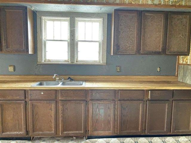 Kitchen featured at 227 Amber St, Iron River, MI 49935