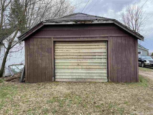 Garage featured at 227 Amber St, Iron River, MI 49935