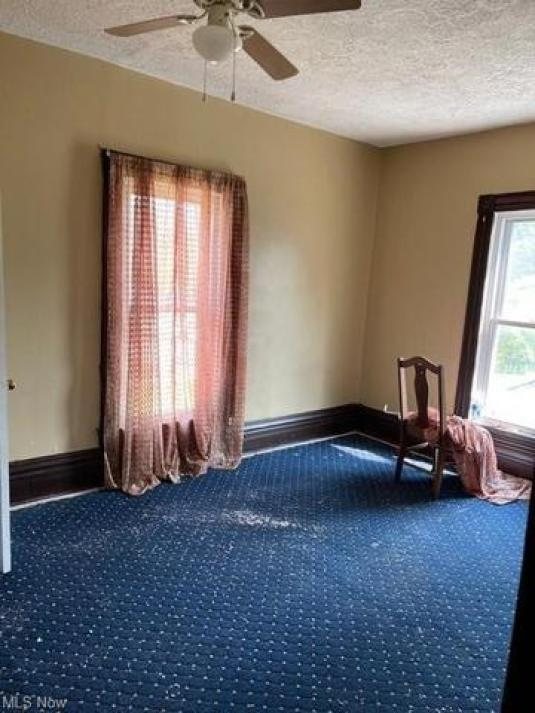 Bedroom featured at 109 W Main St, Salineville, OH 43945