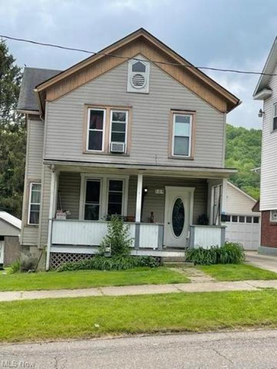 Porch yard featured at 109 W Main St, Salineville, OH 43945