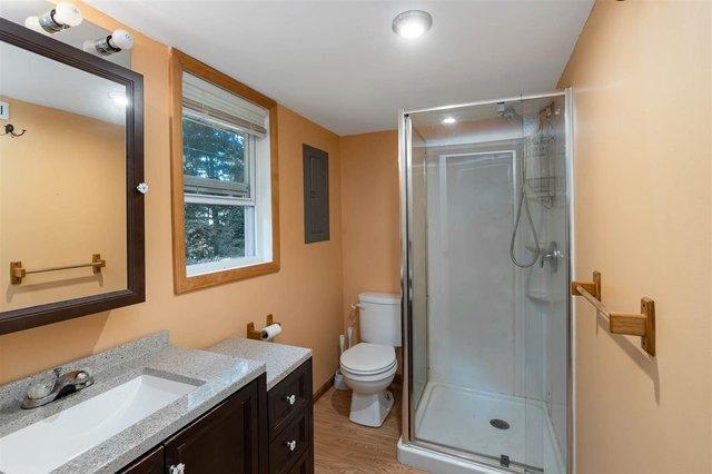 Bathroom featured at 4246 Gilding Rd, Beaverton, MI 48612