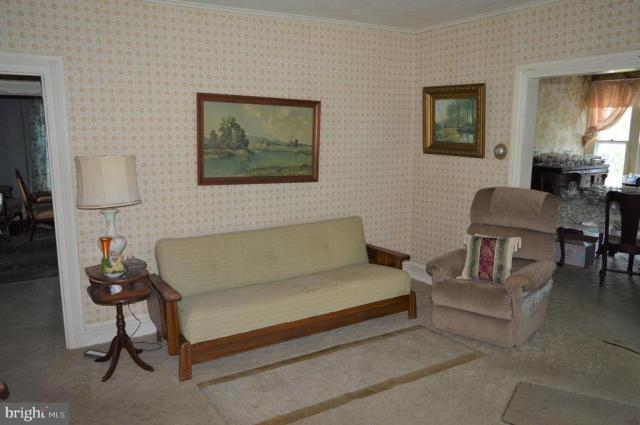 Living room featured at 7 W Main St, Crisfield, MD 21817