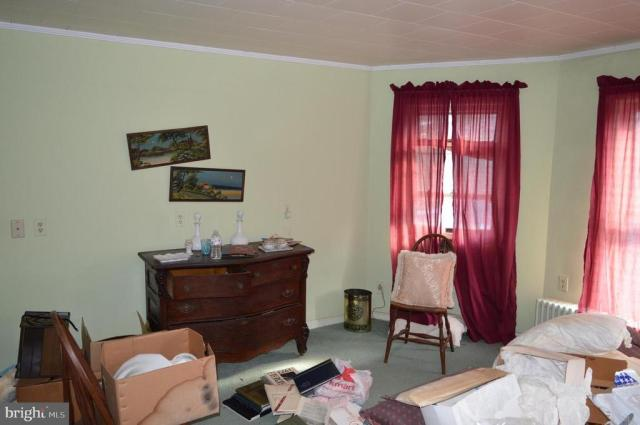 Bedroom featured at 7 W Main St, Crisfield, MD 21817