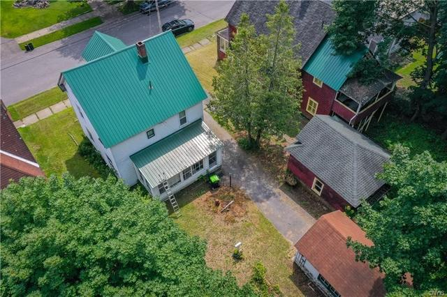 Yard featured at 12 Rundell St, Dolgeville, NY 13329