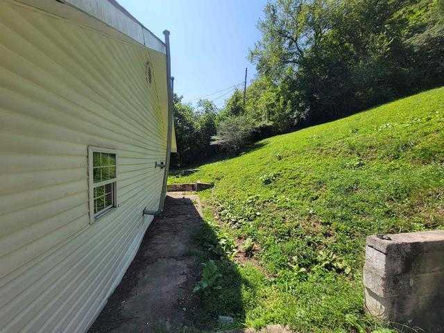 Yard featured at 207 Crum Hollow Rd, Crum, WV 25669