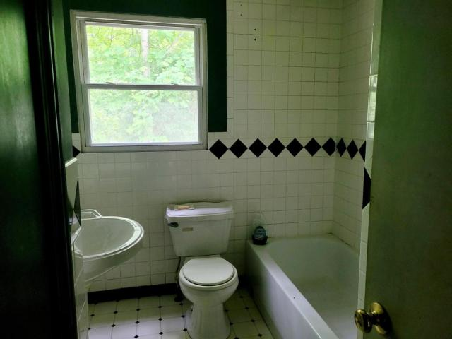Bathroom featured at 1598 The Lake Rd, Clintwood, VA 24228