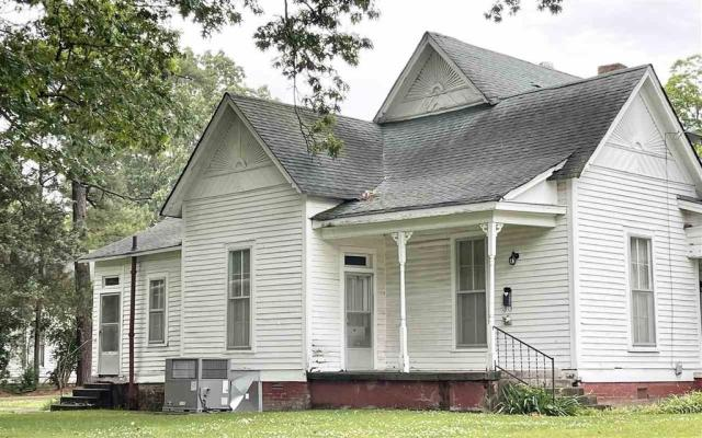 Porch yard featured at 403 College St S, Halls, TN 38040