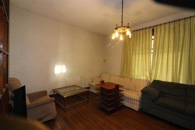 Living room featured at 101 E High St, Linn Grove, IA 51033