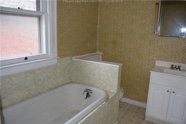 Bathroom featured at 1416 Charleston Ave, Huntington, WV 25701