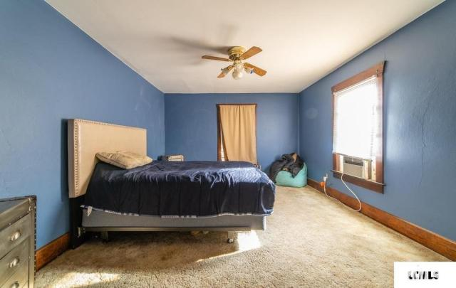 Bedroom featured at 213 N Bogardus St, Elkhart, IL 62634