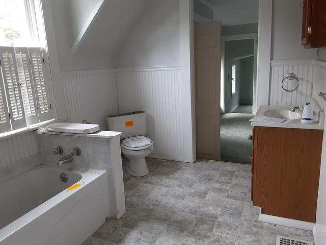 Laundry room featured at 11 Elm St, Houlton, ME 04730