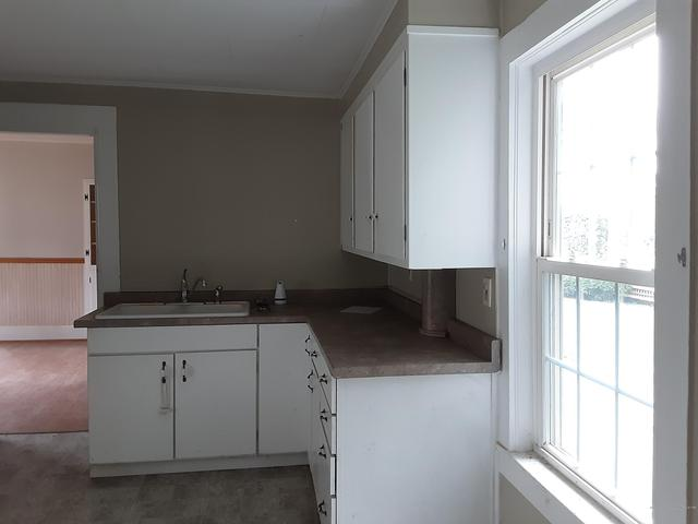 Kitchen featured at 11 Elm St, Houlton, ME 04730