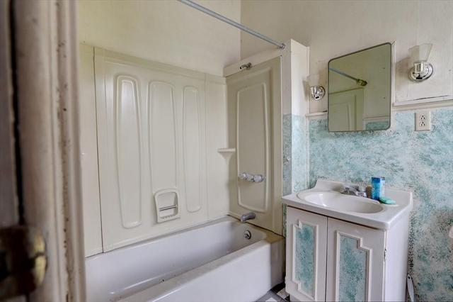 Bathroom featured at 148 Glasgow St, Clyde, NY 14433