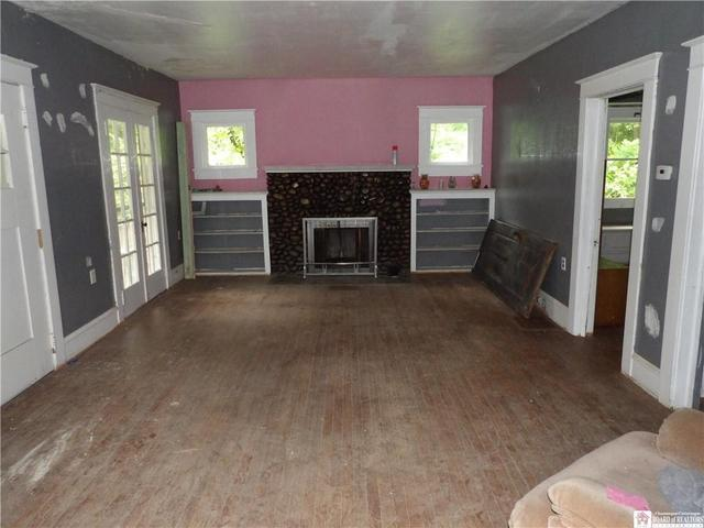 Living room featured at 3035 Route 394, Ashville, NY 14710