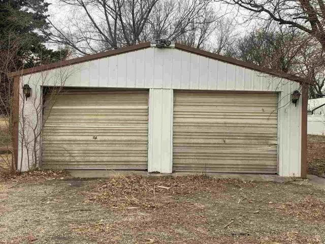 Garage featured at 123 N 3rd St, Osborne, KS 67473