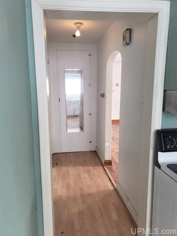 Laundry room featured at 19 Baraga Ave, Lanse, MI 49946
