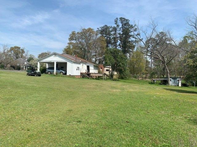 Yard featured at 176 Jones St, Midville, GA 30441