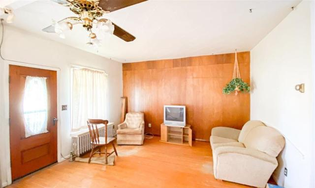 Living room featured at 600 N Main St, Columbus, ND 58727