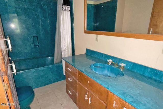 Bathroom featured at 147A Fig Farm Rd, Lucedale, MS 39452