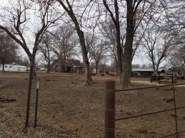 Yard featured at 408 N Locust St, Grenola, KS 67346