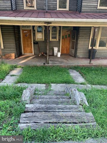 Porch yard featured at 8 and 10 Ridgeway Ter, Cumberland, MD 21502