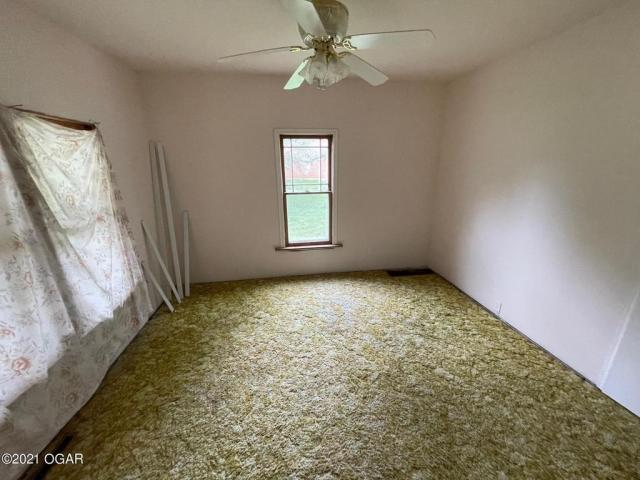 Bedroom featured at 406 E 9th St, Baxter Springs, KS 66713