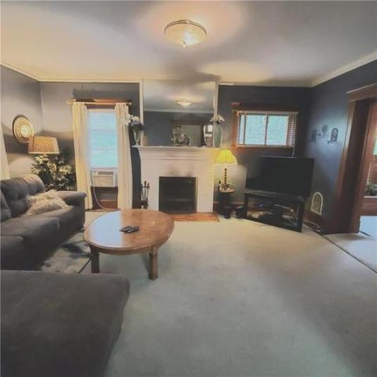 Living room featured at 6137 Wright St, Wolcott, NY 14590