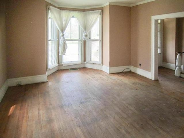 Living room featured at 706 N Gay St, Mount Vernon, OH 43050