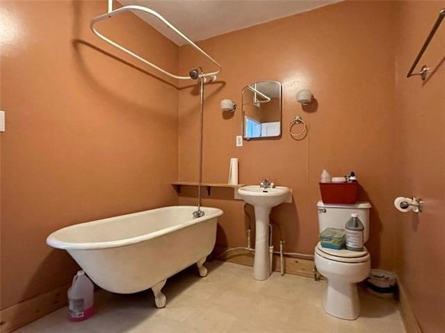 Bathroom featured at 1423 Main St, Trenton, MO 64683