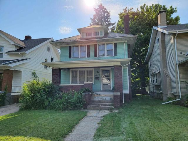 House view featured at 1217 N Bourland Ave, Peoria, IL 61606