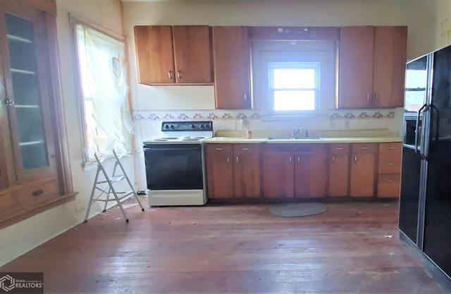 Kitchen featured at 301 Depot St, Promise City, IA 52583