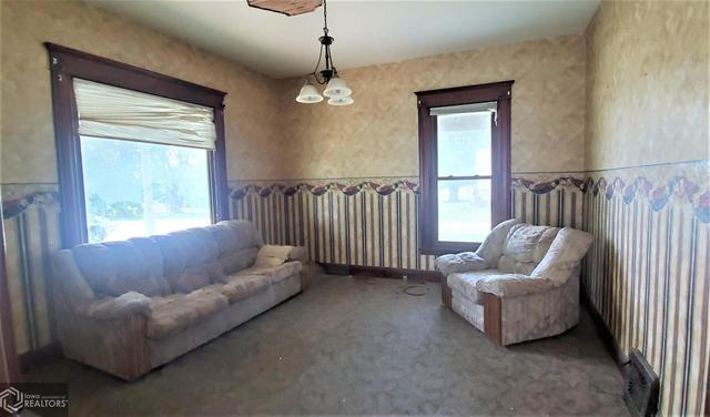 Living room featured at 301 Depot St, Promise City, IA 52583