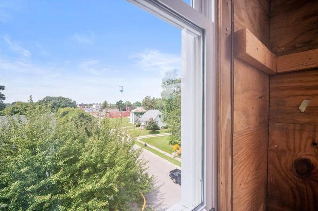 Road view featured at 209 E Church St, Lynn, IN 47355