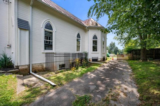 Yard featured at 209 E Church St, Lynn, IN 47355