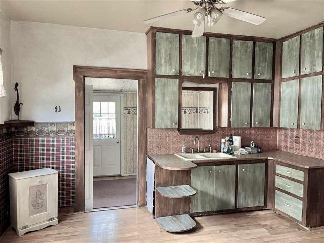 Bathroom featured at 115 S Ash St, Ponca City, OK 74601
