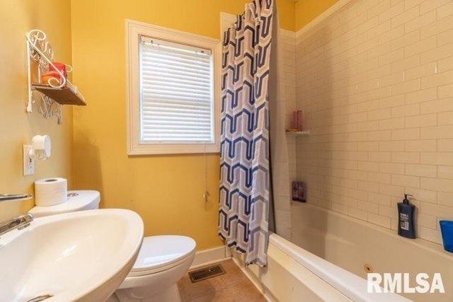 Bathroom featured at 610 E IL Route 17 St, Wenona, IL 61377