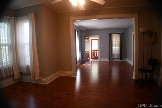 Living room featured at 3545 County Road AAJ Unit 65, Champion, MI 49814