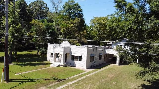 House view featured at 1008 and 1100 Gibson St, Ozark, AR 72949